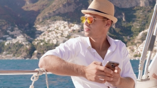 Handsome Successful Man On Yacht White Shirt Talking on Phone Happiness Freedom Yachting Slow Motion Shot Red Epic 8k