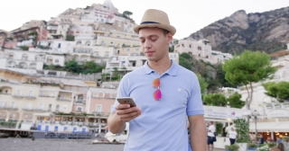 Male Model Looking at Smartphone at Trip in Italy Happiness Sunny Vacation Yachting Slow Motion Shot Red Epic 8k