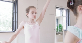 Female Dance Teacher Instructing Children Stretching Exercises Devotion Happiness Slow Motion Red Epic