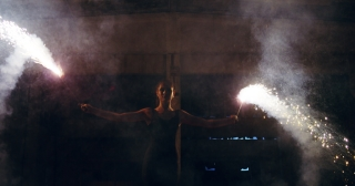 Female Dancer Performing Fire Stunt In Abandoned Building Confidence Nightlife Low Light Slow Motion 8k Red Epic