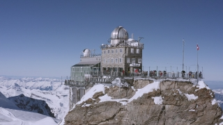 Fly Over Swiss Mountain Range Jungfraujoch Golden Hour European Winter Vacation Cinematic Nature 4k Slow Motion