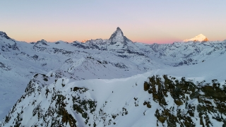 Drone Aerial Flight Over Majestic Mountain Peaks Matterhorn Golden Hour European Winter Vacation Cinematic Nature 4k Slow Motion