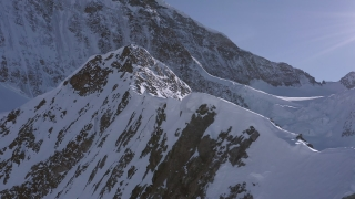 Aerial Flight Over Majestic Mountain Peaks Golden Hour European Winter Vacation Inspiring Nature 4k Slow Motion