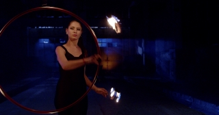 Female Dancer Juggling Fire At Night Playing With Fire Professional Stunt Low Light Slow Motion 8k Red Epic