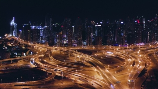 Aerial Of Urban Overpass Junction Skyscrapers At Night Traffic Jam Futuristic Communication City Dubai Business District Low Light Uhd Hdr 4k