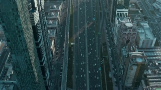 Helicopter Flight Over Urban Skyscrapers At Sunset Traffic Moving Overpass Technological Communication Metropolitan Landscape Low Light Uhd Hdr 4k