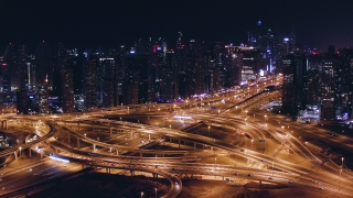 Aerial Around Urban Traffic Junction Overpass Traffic Jam Metropolitan City Skyline Dubai Business District Low Light Uhd Hdr 4k