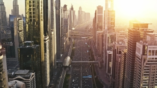 Aerial Flight Between Skyscrapers Golden Hour Sunset Urban Landscape Traffic Jam Junction Futuristic Communication City Business Financial District Low Light Uhd Hdr 4k