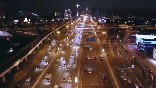 Aerial Flight Over Urban Highway Traffic Rush Hour Traffic City Panorama Dubai Business District Low Light Uhd Hdr 4k