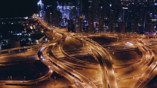 Helicopter Flight Over Urban Skyscrapers Overpass At Night Rush Hour Traffic Metropolitan City Skyline Business Financial District Low Light Uhd Hdr 4k