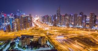 Aerial Flight Over Urban Highway At Night Rush Hour Traffic Metropolitan City Skyline Dubai Business District Low Light Uhd Hdr 4k