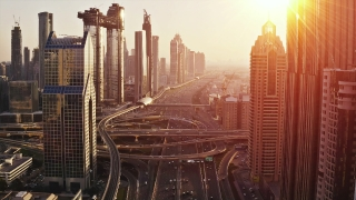 Aerial Shot Of Skyscrapers Urban Traffic at Sunset Traffic Moving Overpass Technological Communication Business Technology Slow Motion Uhd Hdr 4k