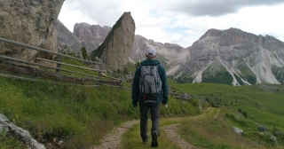 Young Hiker Walking Through Alpine Scenery In The Italian Alps Extreme Vacation Happiness