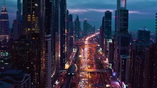 Aerial Shot Of Night Urban Skyline Landscape Traffic Moving Overpass Busy City Transport Dubai Business District Low Light Uhd Hdr 4k