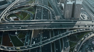 Helicopter Flight Over Urban Highway Overpass At Night Cars Lights Moving Junction Futuristic Communication City Dubai Business District Low Light Uhd Hdr 4k