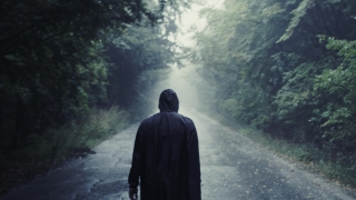 Lonely Hooded Man Walking On Path With Trees At Dusk Youth Depression Travel Slow 8 K