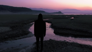 Lonely Hooded Man Watching Sunset At Dusk Youth Depression Travel Slow Motion Drone