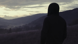 Silhouette Of Sad Man Standing On Empty Field At Golden Hour Youth Depression Nature Tourism Slow Motion 8k