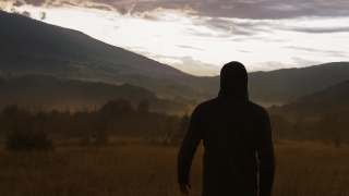 Lonely Hooded Man Standing On Empty Field At Golden Hour Social Distance Travel Slow Motion 8k