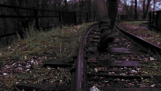 Silhouette Of Sad Man Passing Through Railroad On A Rainy Day Youth Depression Life Journey Slow Motion 4 K Raw