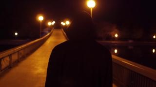 Young Depressed Man Walking On Bridge At Dusk Youth Depression Backpacking Slow Motion 4K Raw