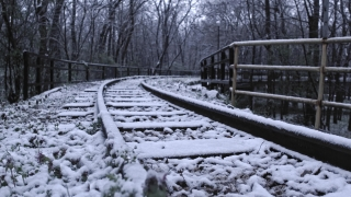 Rusted Railway Track Camera Tracking During Snow Storm Social Distance Social Restrictions Slow Motion 4k Hdr
