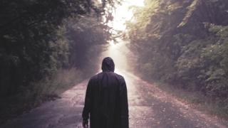 Silhouette Of Sad Man Walking Toward The Light During Rainy Day Youth Depression Life Journey Slow Motion 8 K