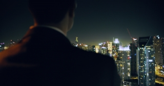 Young Businessman Looking At Business Buildings Skyline Rooftop Urban City View Finance Leadership Night City Lights Slow Motion Red Epic 8k
