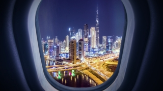 Aerial Urban Timelapse View of Plane Aircraft Window Descending over Dubai City Skyline Airport