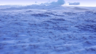 Aerial Shot Of Wind Blowing Winter Mountain Hills Golden Hour Colors Colorful Purple Orange Sky Christmass Holiday Cinematic Flight 4k