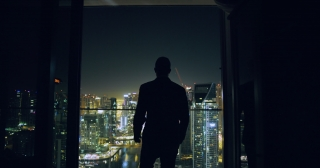 Young Entrepreneur Walking Balcony Business Buildings Skyline Dubai Urban Panorama Success Contemplation Night Financial District Slow Motion Red Epic 8k