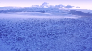 Drone Aerial Over Wind Blowing Winter Mountain Hills Golden Hour Colors Beautiful Colors Sky Christmass Holiday Cinematic Flight 4k