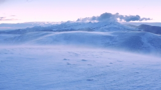 Aerial Flight Over Wind Blowing Winter Mountain Hills At Sunset Sunrise Beautiful Colors Sky Cold Weather Cinematic Flight 4k