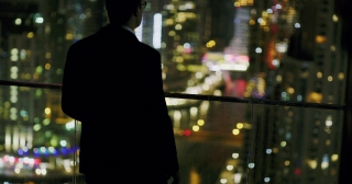 Successful Young Man Looking At City Sky Scrapers Rooftop Urban City View Futuristic Digital Nomad Night City Lights Slow Motion Red Epic 8k