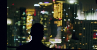 Young Businessman Looking At City Sky Scrapers Rooftop Urban City View Finance Leadership Night City Lights Slow Motion Red Epic 8k