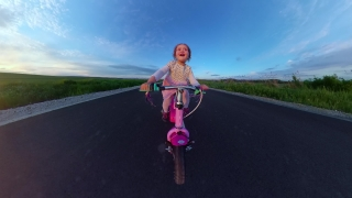 Child Tracking Shot From Behind Having Fun Outdoors Riding Bike At Sunset Outdoor Fun Happy Childhood 360 Vr Footage First Person 8k Slow Motion