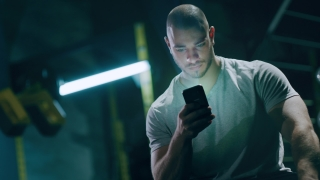 Close Up Shot Of Male Bodybuilder At Gym With Smartphone Identified by Biometric Facial Recognition Scanning Process Face Detection Face Match 3D Scanning ID Red Epic 8k