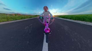 Cute Female Toddler Riding Bicycle Outside Looking At Golden Sunset Harmony And Happiness Happy Childhood 360 Vr Footage First Person 8k Slow Motion
