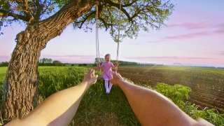 POV Father Swinging Her Child Playing Under A Tree During Sunset Travel Restrictions Happy Family 360 Vr Footage First Person 8k Slow Motion