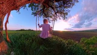 Rear View Of Pretty Girl Child Sitting On A Wooden Swing Enjoying Sunset During Vacation Dream Happy Childhood 360 Vr Footage First Person 8k Slow Motion