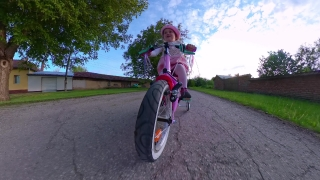 Cute Female Toddler Riding Bike Tracking Shot Playing Outdoors Sunset Quarantine Nature Fun Family Happy Childhood Concept Travel 360 Vr Footage First Person 8k Slow Motion