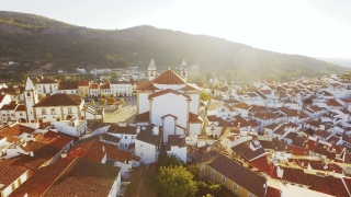 Drone Footage Church Tower Aerial Community Mountain Sunlight Landscape Travel Portugal Residential Crowded Famous Roof Historic Europe 4K Nature Tourism