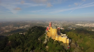 Aerial Drone Footage Pena National Palace Mountaintop Romanticist Sintra Famous Travel Portugal Historic Lisbon Architecture Trees Europe Gothic 4K Landscape