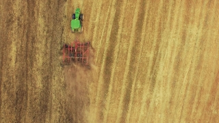 Drone Footage Tractor Ploughing Field Aerial Agriculture Cultivation Farming Dirt Equipment Preparing Landscape Machinery Lines 4K Rural
