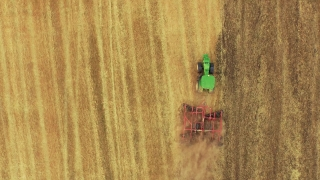 Tractor Ploughing Field Aerial Drone Footage Agriculture Cultivation Farming Dirt Equipment Preparing Landscape Machinery 4K Rural Lines