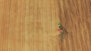 Aerial Footage Agriculture Tractor Ploughing Field Cultivation Dirt Farming Equipment Lines Landscape Machinery Preparing Drone Rural 4K