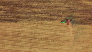 Aerial Footage Farming Green Tractor Ploughing Field Agriculture Cultivation Dirt Landscape Rural Drone Equipment Machinery Trailer