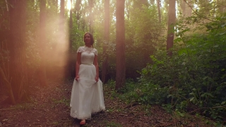 Fairy Tale Princess Bride Walking In Enchanted Forest Sunset Rays Bride White Dress Vintage Style Fashion Smiling Happy Beauty Nature Concept