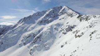 Aerial Flight Over Beautiful Mountains Alpine Mountain Ridge Rocky Peak Snow Winter Landscape Nature Outdoors Epic Adventure Inspiration Background