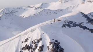Aerial Flight Over Mountain Peak Epic Winter Vacation Landscape